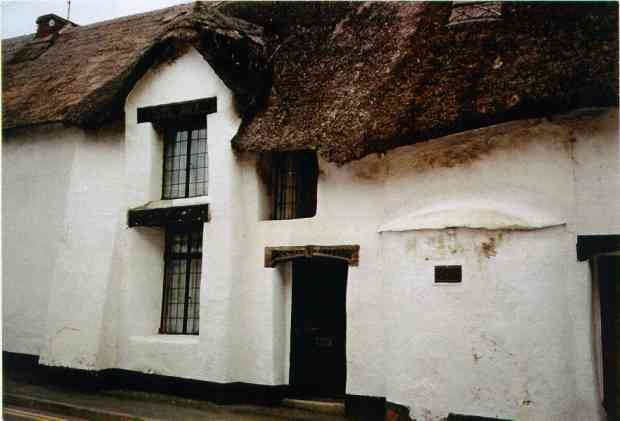 Ancient cob building in Devon, England. The date plate reads 1539.