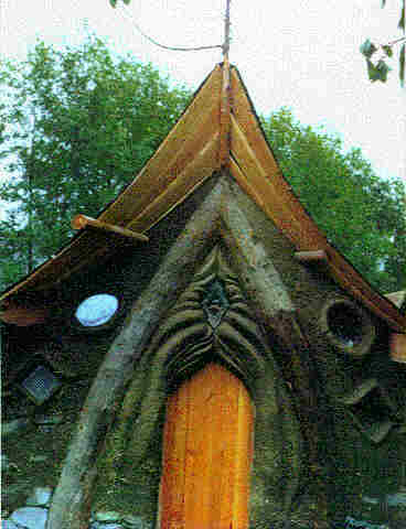 Close-up view of sculptural use of cob on entrance.
